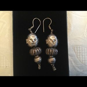 Ancient men drop earrings.